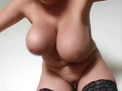 Chubby Brunette With Big Tits Stripping In Kitchen