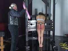 Young Bound Brunette With Huge Fish Tatoo Gets Her Ass Spanked