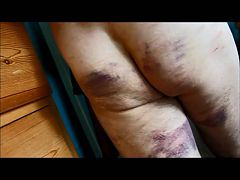 Men Caned On The Bed