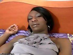 Long Haired Ebony Tranny Teases The Camera