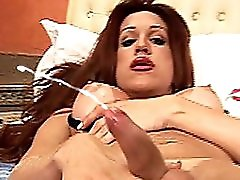 Redhead Shemale Squirts Lotion On Her Shecock And Jerks Off